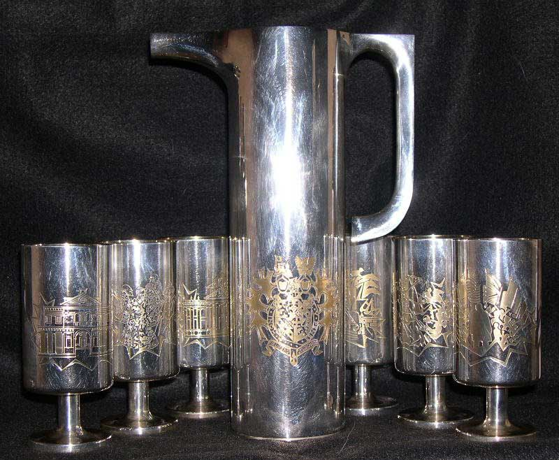 6 Silver Goblets and Claret Jug showing unique engraving on each goblet depicting Churchill's life