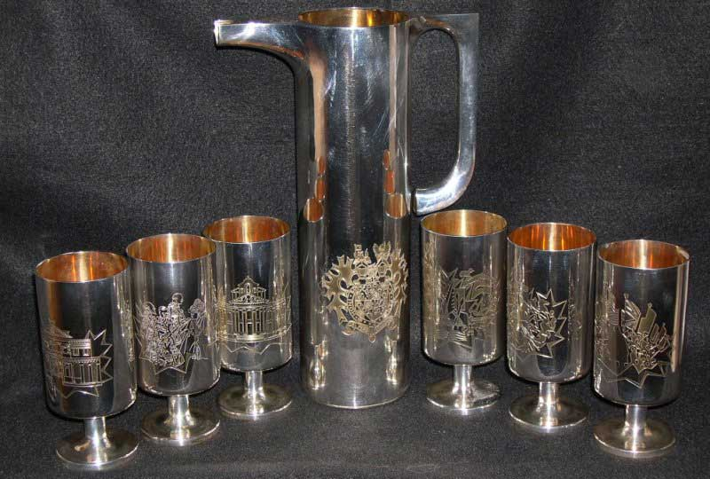 6 Silver Goblets and Claret Jug Garrads & Co., the Crown Jewelers