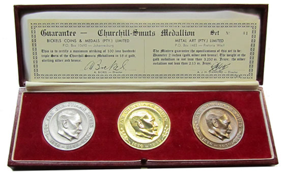 3 coins in presentation case featuring Smuts (Churchill is on the other side)