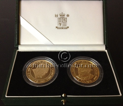 2 5pound coins in blue leather presentation case